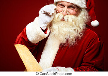 Kind Santa Claus - Portrait of happy Santa Claus holding...