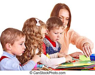 Kindergarden teacher with children.