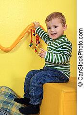 Kindergarten - Cute european toddler having fun in...