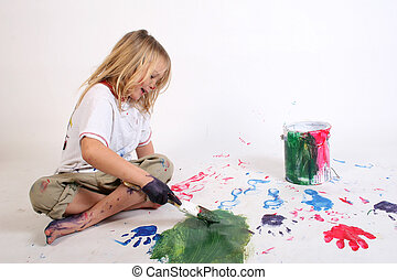 kindergarten paintin - a young girl painting a picture