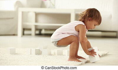 Kindergarten pastime - Busy youngster playing with wooden...