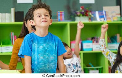 Kindergarten students stand up in classroom,preschool international education concept
