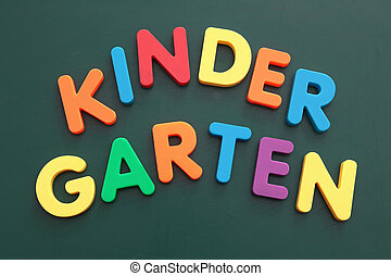 The word kindergarten built out of colored bold letters on a blackboard.
