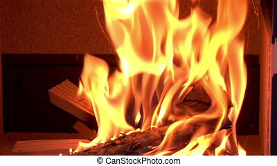 kindling burns in wood stove