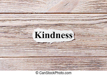 kindness of the word on paper. concept. Words of kindness on a wooden background