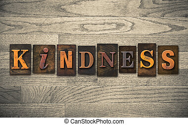 """The word """"KINDNESS"""" written in vintage wooden letterpress type."""