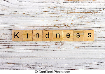 Kindness word made with wooden blocks concept
