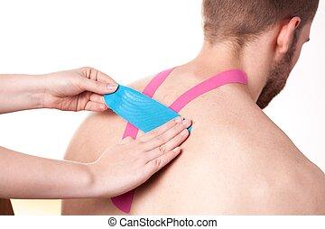 kinesio, het vastbinden, op, hogere rug