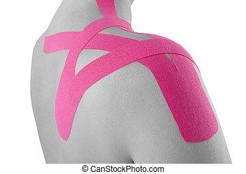 Kinesio tape on female shoulder isolated on white...