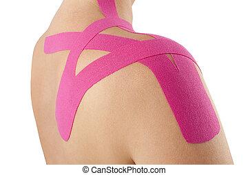 Kinesio tape on pregnant. - Kinesio tape on shoulder on...