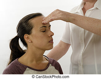 Kinesiologist treating Neuro vascular holding - emotional stress release