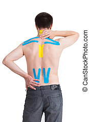 Kinesiology taping on human back, isolated on white...