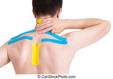 Kinesiology taping on human back