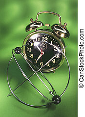 Kinetic Mobile and Alarm Clock on Green Background