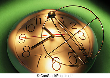 Kinetic Mobile and Clock with Green Background