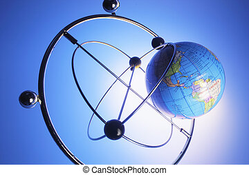 Kinetic Mobile and Globe with Blue Background