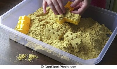 Kinetic sand heap for children. Kinetic sand close-up.