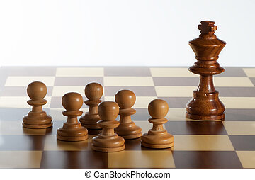 king and pawns - photography of king chess with many pawns