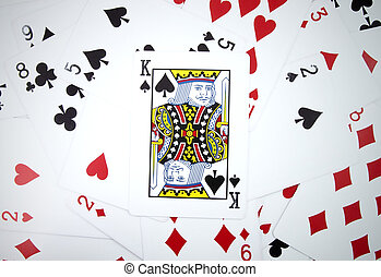 King card with playing cards background