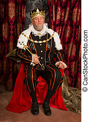 King on throne - King in tudor costume sitting on his throne...