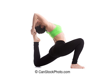 happy yoga girl in royal pigeon pose portrait of