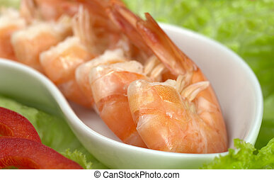 King prawn in bowl, on lettuce with red bell pepper