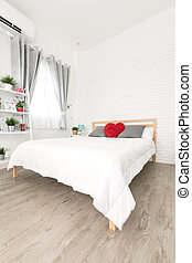 King-size bed in bright bedroom