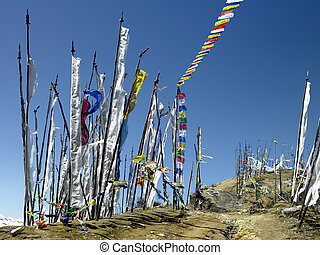 Buddhist prayer flags on a hillside high in the Himalayas in the Kingdom of Bhutan.
