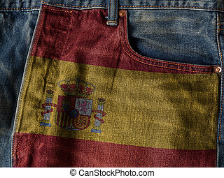 Kingdom of Spain flag On Jeans Denim Texture. The concept of Kingdom of Spain national flag on denim Jeans background. Ideal for Spain Textile Industry Or Politics Concept.