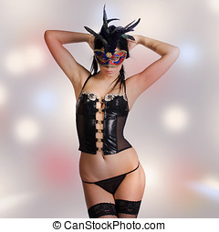 kinky woman with venetian mask and lingerie