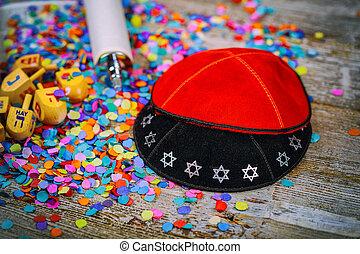 Kippahs Yarmulkes Jewish Wooden dreidel for Hanukkah on Torah and a kippah also called a yamolka