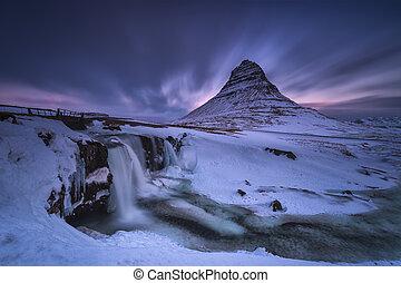 Kirkjufell and Kirkjufellfoss snowed in a cold winter