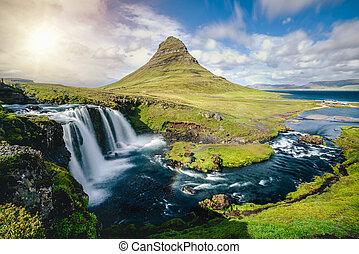 Kirkjufell mountain landscape in Iceland summer.