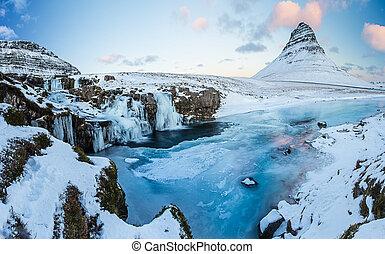 Kirkjufell waterfall with mountain in winter, Iceland