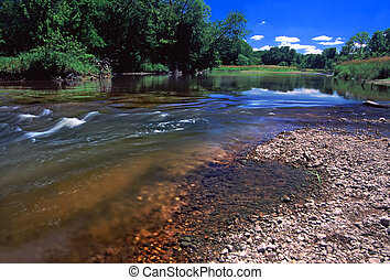 Swift current of the Kishwaukee River in Boone County Illinois.