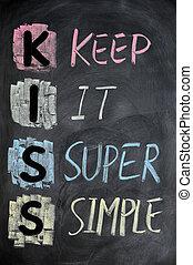 KISS acronym written in colorful chalk on a blackboard