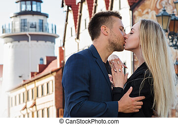 Kiss. Loving couple on a background of romantic old European city