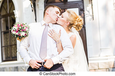 Kiss the bride and groom