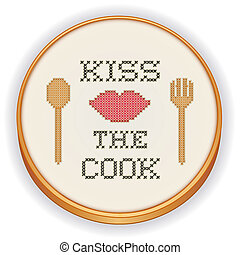 Retro wood embroidery hoop with cross stitch needlework design, Kiss the Cook with big red lips, cooking fork and spoon, isolated on white background.