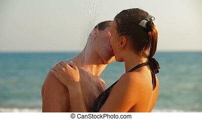 Kiss Under Shower On a Summer Beach