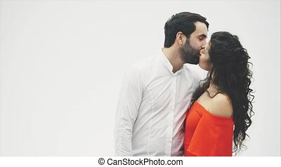 Kissing a pair of stays on a white background. from the...