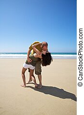kissing couple at beach