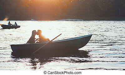 Kissing couple at sunset