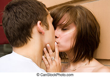 Kissing Couple - Happy young couple spending time together ...