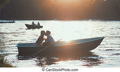 Kissing couple in a boat