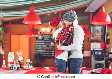 Kissing couple on a date in a cafe