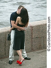 kissing couple on the bank of Neva river
