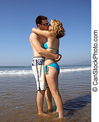 Kissing couple - A young kissing couple on the beach