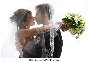 Kissing couple wedding portrait - Wedding portrait of...