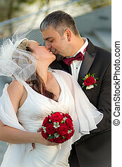 Kissing happy young couple